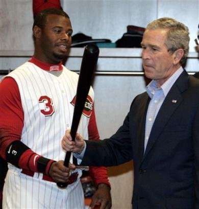 President Bush admires Ken Griffey Jr.'s fine piece of lumber.