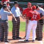 First base coach Hatcher hands off the lineup card