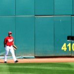 Heisey catches a ball at the outfield wall