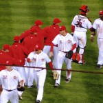 The Reds congratulate each other on their second win of the season