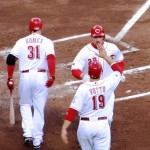 Rolen high-fives Votto after Rolen's first home run of the season