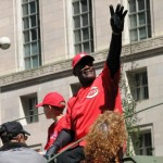 George Foster waves to the parade crowd.