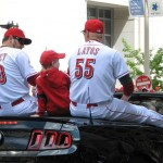 Nick Massett and Mat Latos on the back of a sports car