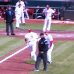 Joey Votto rounds third and high-fives Mark Berry after his home run.