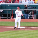 Joey Votto throws a grounder to second before the game started.