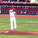 Mat Latos throws his first pitch as a Red on Opening Night.