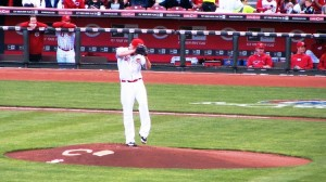 Latos winds up to deliver the first pitch