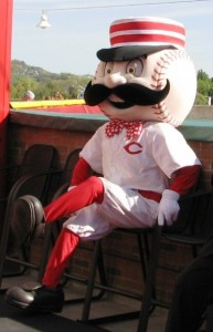 Mr. Redlegs, sporting a snazzy bowtie, takes a break during his red carpet walk.