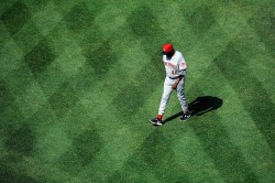 Dusty Baker walks across the outfield