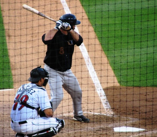 Corky Miller batting before singling up the middle.