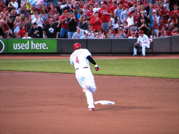 Brandon Phillips rounds second after his solo home run that gave the Reds the lead.