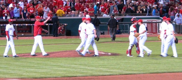 The Reds high five each other after the win.