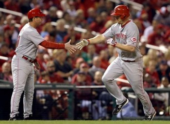 Mark Berry offers congratulations to Scott Rolen after a game-tying home run.