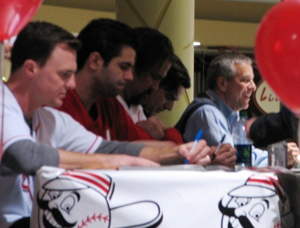 Jay Bruce, Ryan Lamarre, Corky Miller, Phil Castellini, and Thom Brennaman on the dais, signing merchandise for fans.