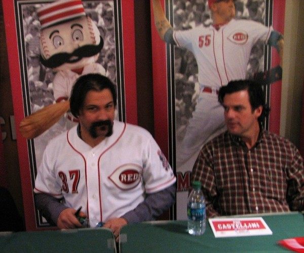 Corky Miller has no clue that he's about to be beaned by Mr. Redleg's bat.