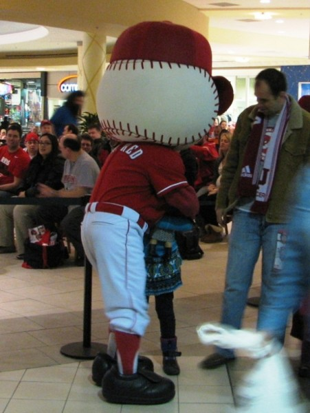 Mr. Red entertains fans while everyone waits for the Reds to arrive.