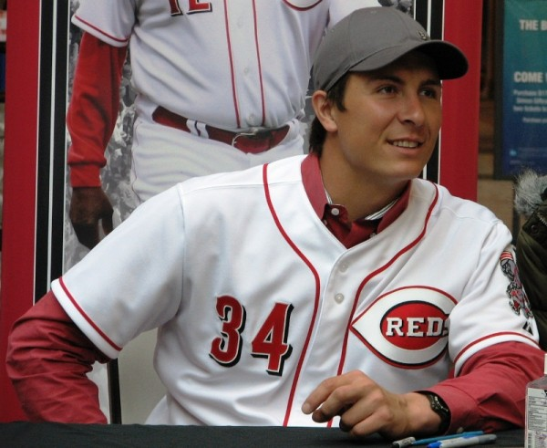 Homer Bailey smiles as he leans in for a forbidden photo with a fan.