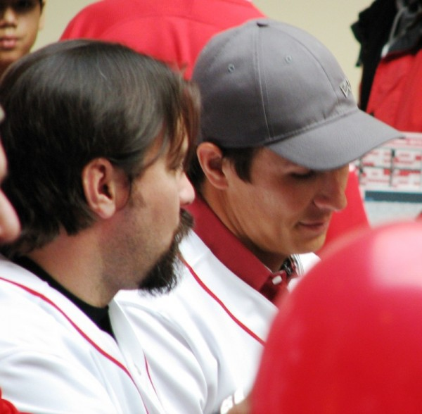 Corky Miller and Homer Bailey chat while signing.