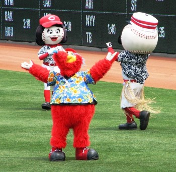 The Reds mascot wear tropical shirts to honor the Beach Boys.