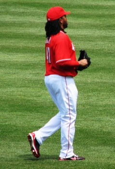 Johnny Cueto warms up in the outfield.