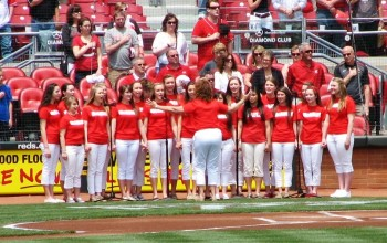 A high school vocal group sang the National Anthem.