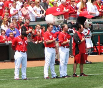 Derrick Robinson, Jay Bruce, and Zack Cozart during the National Anthem.