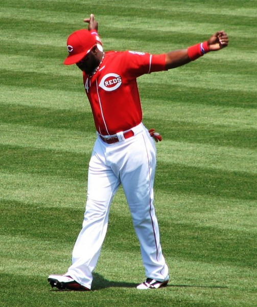 Phillips loosens his arms before the game