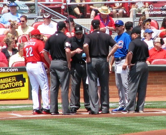 Hatcher delivers the lineup card to the umpires