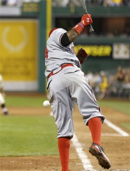 Brandon Phillips is probably in some pain in this picture, but I still admire the high socks. (AP Photo/Keith Srakocic)