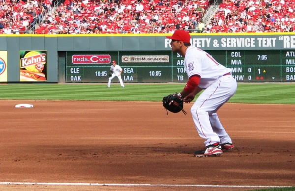Votto crouches at first as the pitch is delivered.