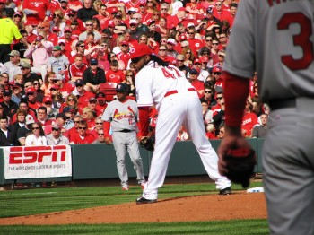 Cueto checks the runner.