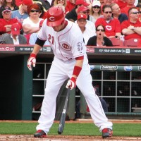 Frazier taps the plate with his bat.
