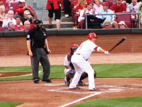 Votto stretching out his bat while waiting on the pitch