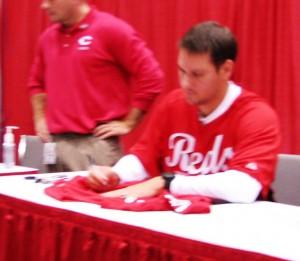 Janish signing autographs.