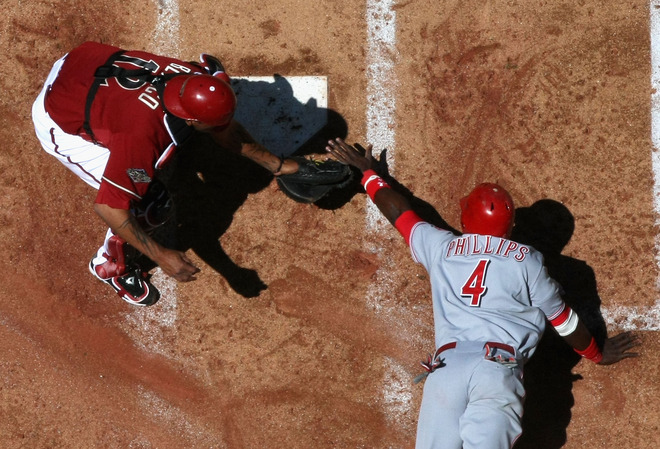 This must be how god sees Brandon Phillips get tagged out at the plate.