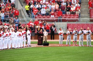 Cardinals and Reds players line up for the anthem