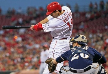 Joey Votto hits the double that brings in the Reds' only run (AP Photo/Al Behrman)
