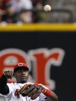 Brandon Phillips throws from his seat at second base. (Photo by Joe Robbins/Getty Images)