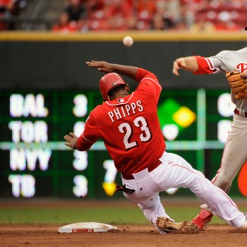 Denis Phipps tries to break up a double play.  (Photo by Jamie Sabau/Getty Images)