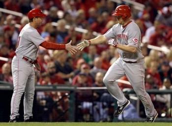 Mark Berry offers congratulations to Scott Rolen after a game-tying home run.