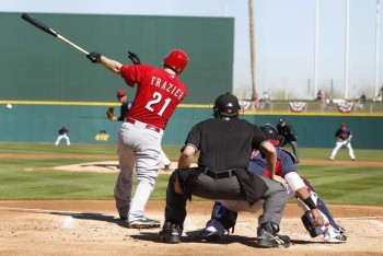 Todd Frazier singles in the first inning, knocking in Joey Votto.
