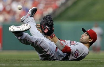 Joey Votto throws from his back to make the final out in a game against the Cardinals