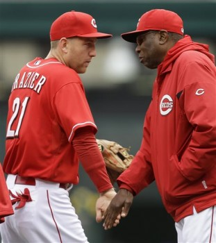 Cincinnati Reds manager Dusty Baker, right, congratulates third baseman Todd Frazier (21) after they defeated the Chicago Cubs 1-0 in a baseball game on Wednesday, April 24, 2013, in Cincinnati. Frazier accounted for the game's only run with a home run. (AP Photo/Al Behrman)