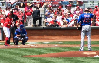 Garza throws the first pitch of the game
