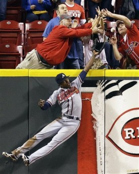 Mexoraco's home run was just barely over the wall, which is just fine with these front-row fans. (AP Photo/Al Behrman)