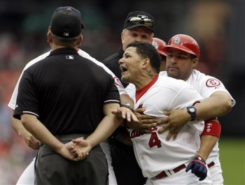 It's nice that Yadi has his brother at first base coach to make a big show of holding him back. (AP Photo/Jeff Roberson)