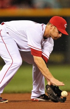 Cozart fields the ball in the rain.