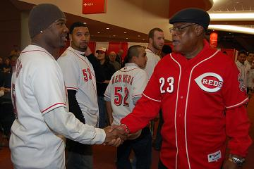 Reds great Lee May greets newest Reds reliever Arthur Rhodes. Credit: The Cincinnati Reds