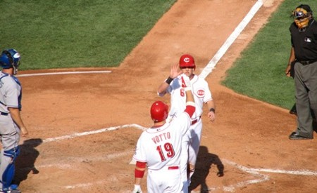 Votto high-fives Stubbs for scoring