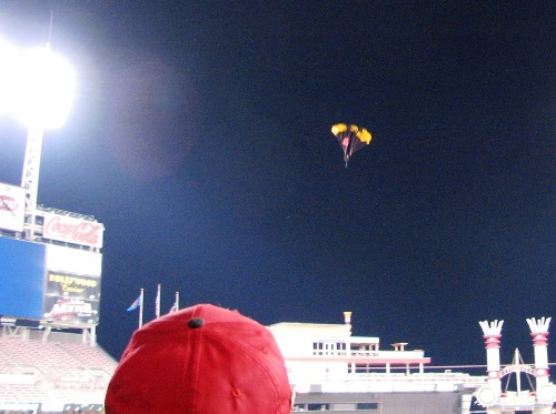Army dude parachuting onto the field after the game